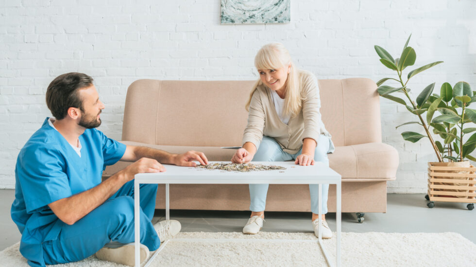Woman and Caregiver Playing a Game