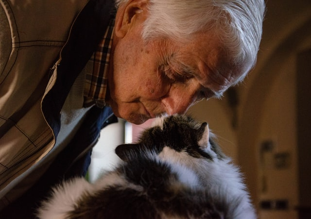 Elderly Man With His Cat